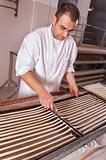 Baker makes the bread sticks
