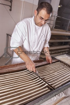 Baker makes the bread sticks