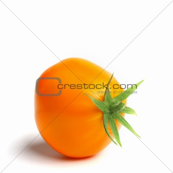 orange tomato on white