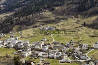 Small town at slope of Alp mountain