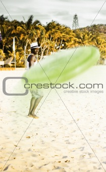 Man Playing Frisbee On Beach