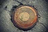 rusty round manhole