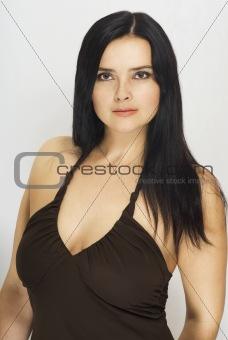 Beautiful woman with long dark hair in an open dress