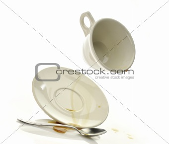 Cup and saucer with spilled coffee