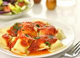 Ravioli pasta with red tomato sauce