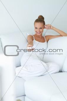 Cute woman watching tv on sofa