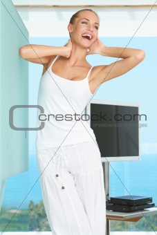 Elegant shapely woman stretching