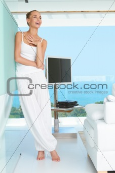 Woman laughing in modern living-room