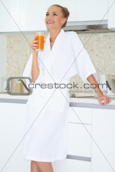 Woman enjoying fresh orange juice for breakfast