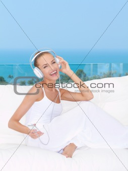 Vivacious woman listening to music