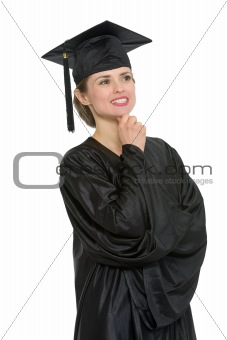 Portrait of thoughtful graduation woman isolated