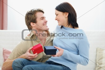 Romantic couple exchanging presents