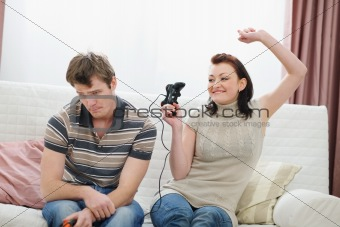 Girl rejoicing that beat boyfriend in console