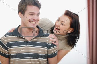 Portrait of smiling young couple having fun