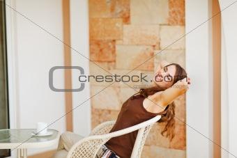 Beautiful woman relaxing on terrace