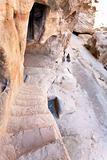 steep ancient stone steps to antique living chamber in Little Petra