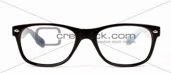 Pair of black modern eye glasses over white background