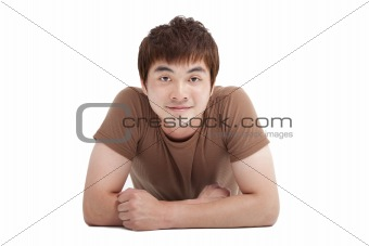 asian young man lying on the floor isolated on white