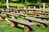 outdoor wood benches on green lawn
