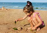 Little girl playing on the seaside