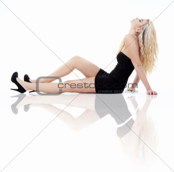 young woman with blond hair in black dress - isolated on white