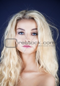 portrait of a young beautiful woman with long blond hair