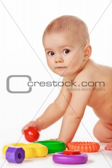 Baby play with toys on white background in studio