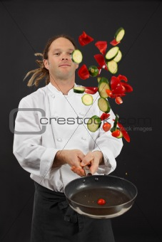Tossing vegetables while cooking