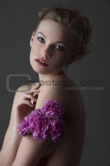 low key girl with purple carnation flower