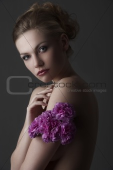 elegant girl portrait with purple carnation flower