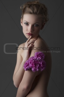 attractive girl portrait with purple carnation flower