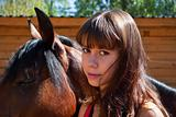 Portrait of the beautiful girl with a horse