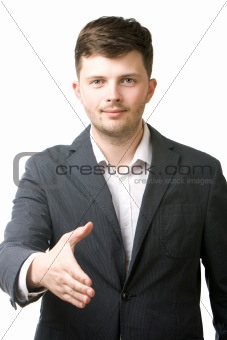 Portrait of positive business man giving his hand for a handshake