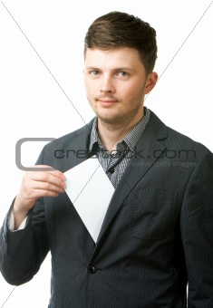 Young businessman taking blank paper out of pocket