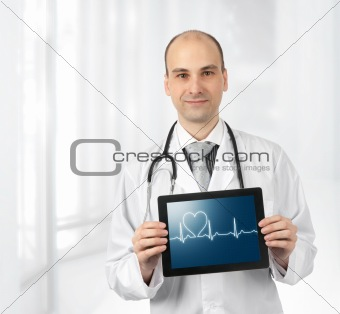 Smiling doctor with hearts beat diagram on a tablet computer
