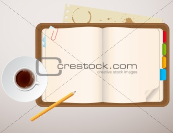 notebook and a cup of coffee