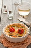 Quiche with asparagus and tomatoes