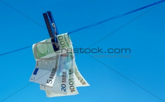 euro money banknotes hanging on clothesline