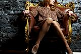 Model in armchair