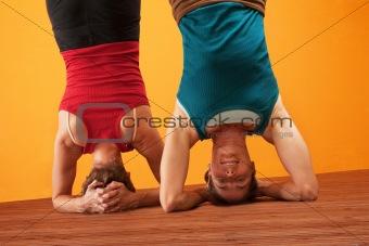 Fit Women Doing Headstands