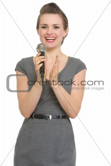 Woman reporter with microphone applauding isolated