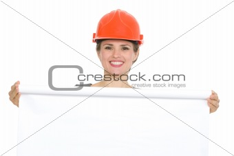 Portrait of smiling architect woman with blank flipchart isolated