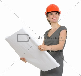 Portrait of dreaming architect woman with open flip chart isolated