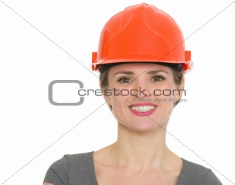 Portrait of smiling architect woman in helmet isolated