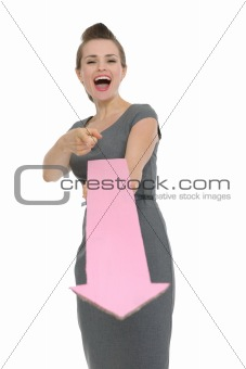 Business woman with big arrow pointing in camera isolated