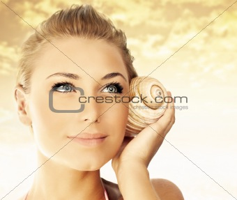 Beautiful woman face over beach sunset