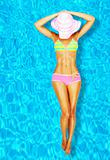 Sexy woman body in the pool