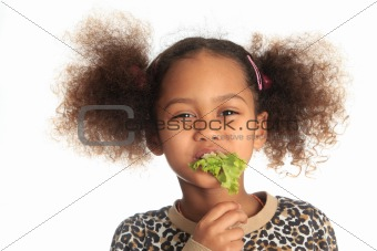 beautiful child  asian African American Black child eats salad i