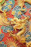 Statue of golden dragon on the wall