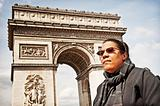Girl In Wheelchair In Front Of Arc de Triomphe